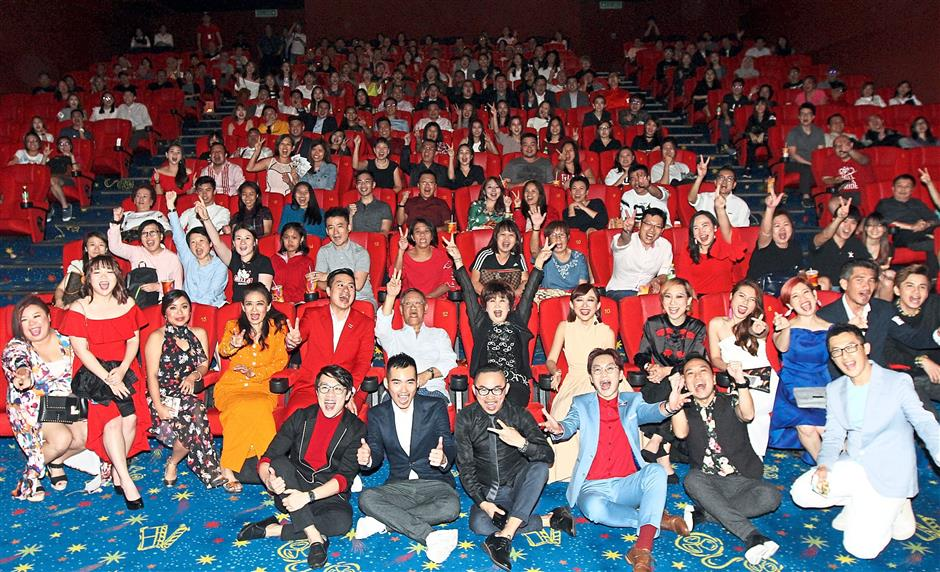 Guests at the premiere of 'House Of Happiness' posing for the camera. — Photos: M. AZHAR ARIF and LOW BOON TAT/The Star