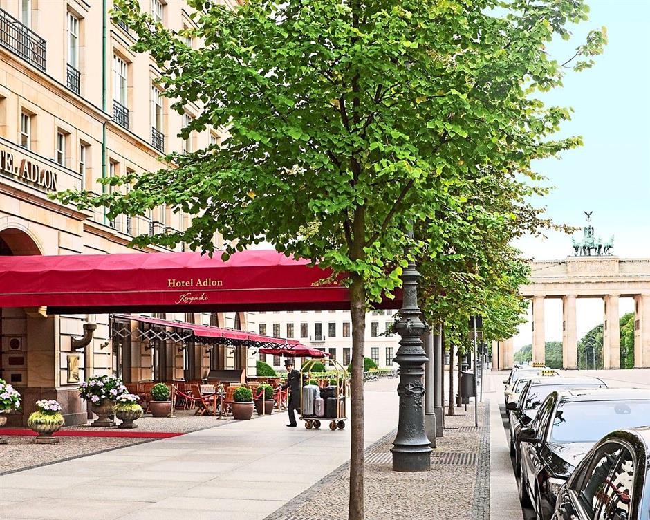 Berlin hotel: The entrance to Hotel Adlon Kempinski. Behind is the historical Brandenburg Gate.