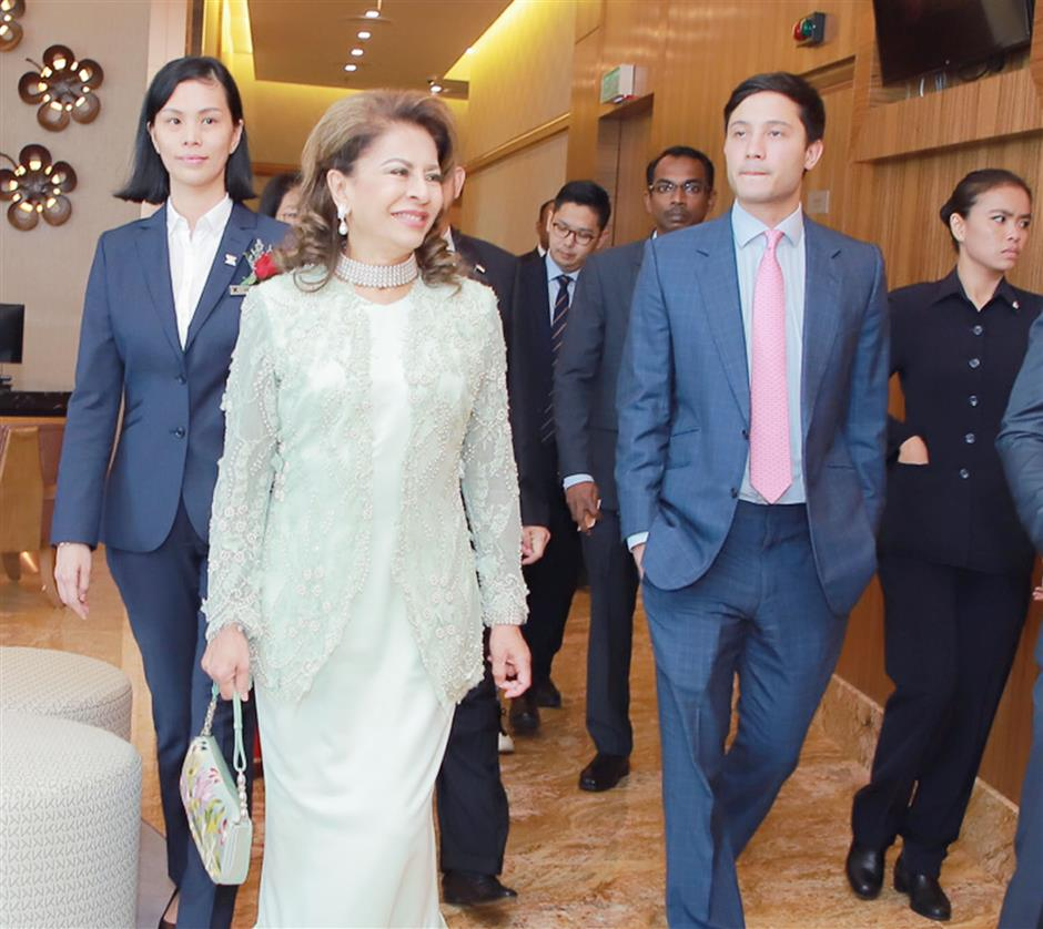 Sultanah Pahang Sultanah Kalsom (second from left) taking a tour around The Zenith Hotel Putrajaya during its soft opening.