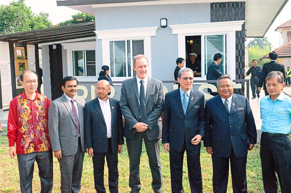 Promoting sustainable construction: Representatives from the Works Ministry, Bayer, CIDB and PU Profile posing outside the Bayer and CIDB Affordable Housing Project's Model House.