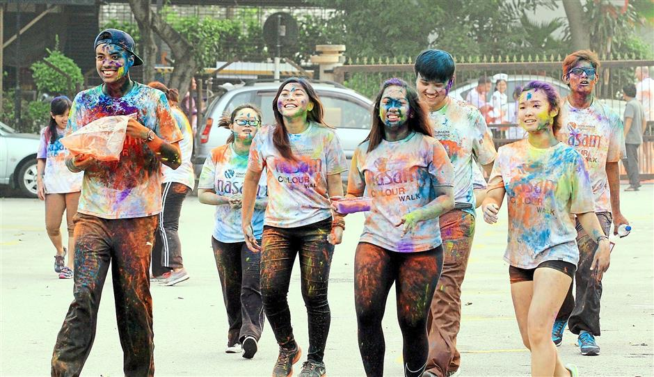 Colour powder was thrown at the participants at various checkpoints along the designated route.