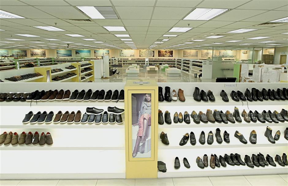 6b430db91 Made for walking: Kong Brothers' 21,600 sq ft showroom displays over 30,000  different shoe designs.