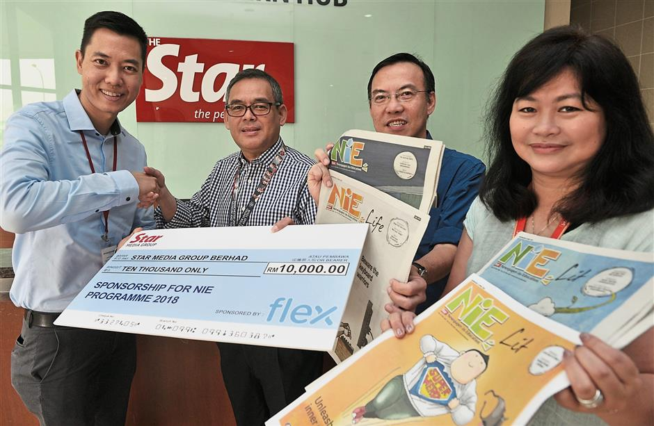 (From left) Ho presenting Flexu2019s NiE sponsorship to Star Media Group executive editor Rozaid Abdul Rahman, Chief Reporter Alex Teng and audience  management  senior manager (north) Oun Sui Leng at the Star Northern Hub in Bayan Lepas.