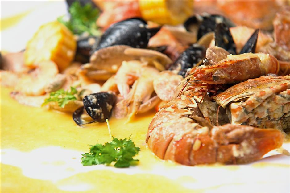 This seafood combo comes with Creamy Butter Lemon Sauce.
