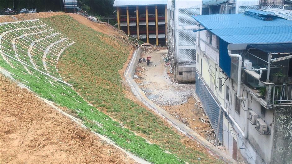 DBKL is installing beam grids and performed soil nailing to strengthen a slope Jalan Tuba at Kg Attap.