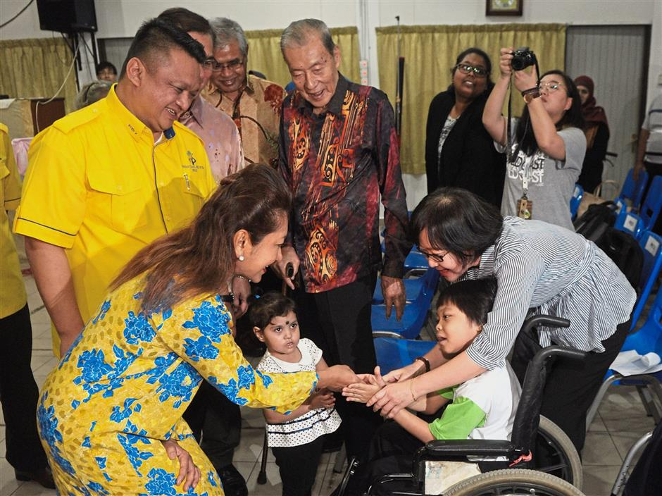 The Raja Muda and Tuanku Lailatul meeting Nur Alya Adriana Redzuan at the Cerebral Palsy (Spastic) Children's Association. — Photos: ASRI ABDUL GHANI/ The Star