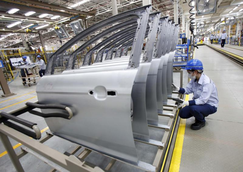 An employee works at an assembly line in the new Ford Thailand manufacturing plant located in Rayong province, East of Bangkok. Thai factory output declined slightly less than expected in January, but it marked the 10th consecutive month of reduced activity, indicating declining domestic demand as the political crisis in the kingdom drags on - Reuters Photo.