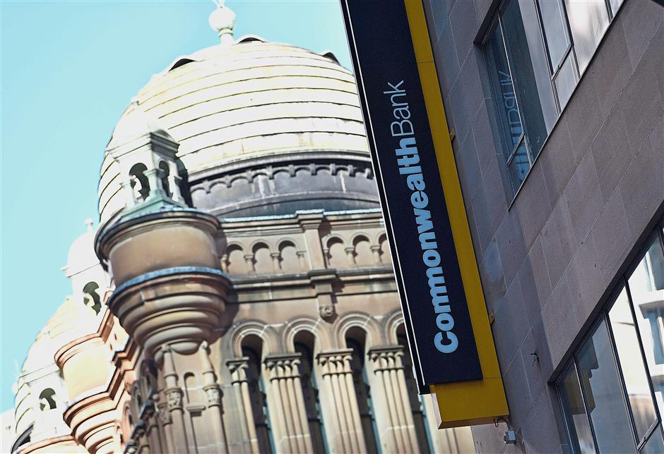 FILES-- This file photo taken on May 1, 2018 shows a signage for Australias biggest company, the Commonwealth Bank, is seen on a building in Sydney.Australias troubled Commonwealth Bank admitted on May 3, 2018 it has lost financial records for almost 20 million customers in a major security blunder, but insisted there was no need to worry. / AFP PHOTO / SAEED KHAN