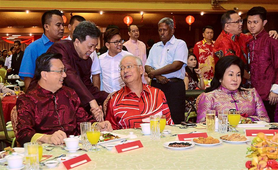 Prosperous greetings: Star Publications (M) Bhd group managing director and CEO Datuk Seri Wong Chun Wai shaking hands with Najib who was accompanied by Rosmah during the MCA Chinese New Year celebration at the partyu2019s headquarters in Kuala Lumpur while Liow (left) looks on. Standing at right is MCA Youth chief Chong Sin Woon.