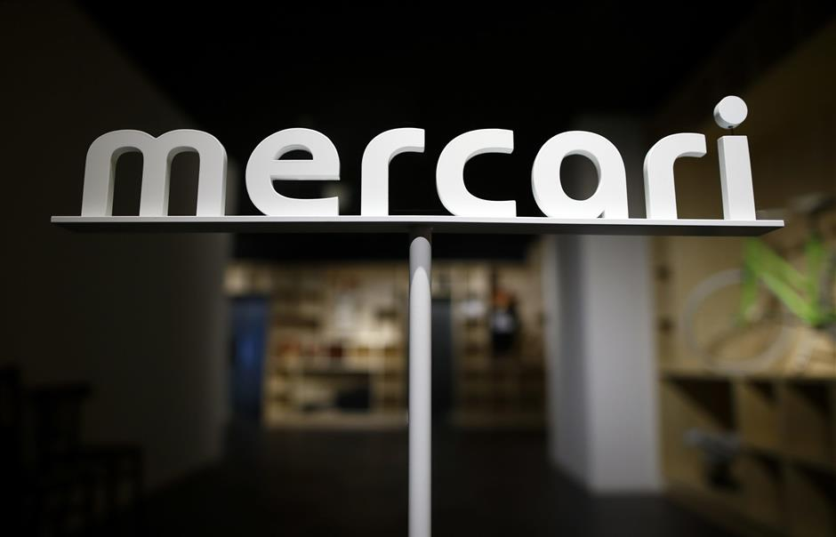 Logo of Mercari Inc. is displayed at the entrance to the company\'s office in Tokyo, Japan, on Friday, March 11, 2016. Mercari, a mobile e-commerce site that matches individual buyers and sellers, this month became the first Japanese startup worth at least $1 billion. Photographer: Tomohiro Ohsumi/Bloomberg