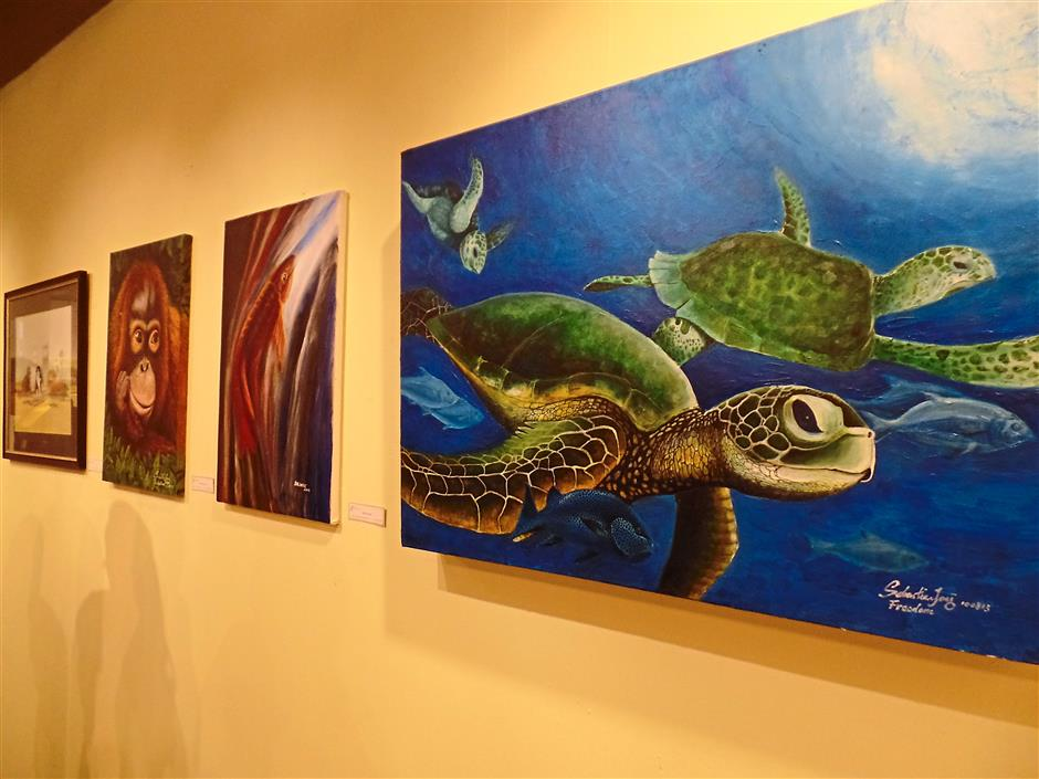 Wild art: Realistic looking animal paintings exhibited at the Gawai Art Festival gallery at Sarawak Plaza.