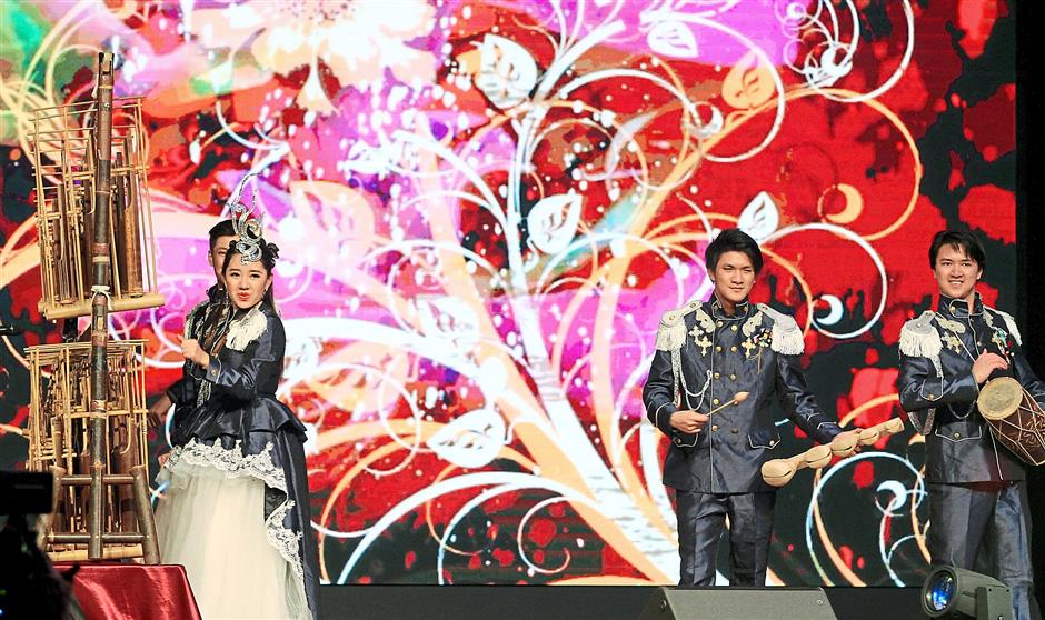 Chee, the first female magician to receive the prestigious Merlin Award-USA, and her siblings playing the angklung.