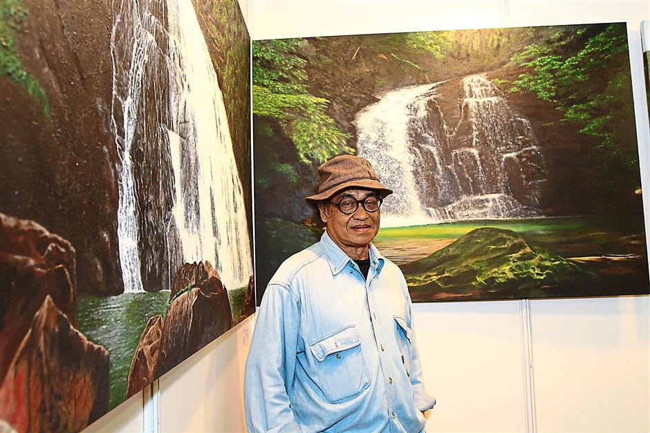 Malaysian artist Abdul Hanan Dalail, 71, draws inspiration from the forests of Johor for his series of paintings displayed at Art Asia 2015.