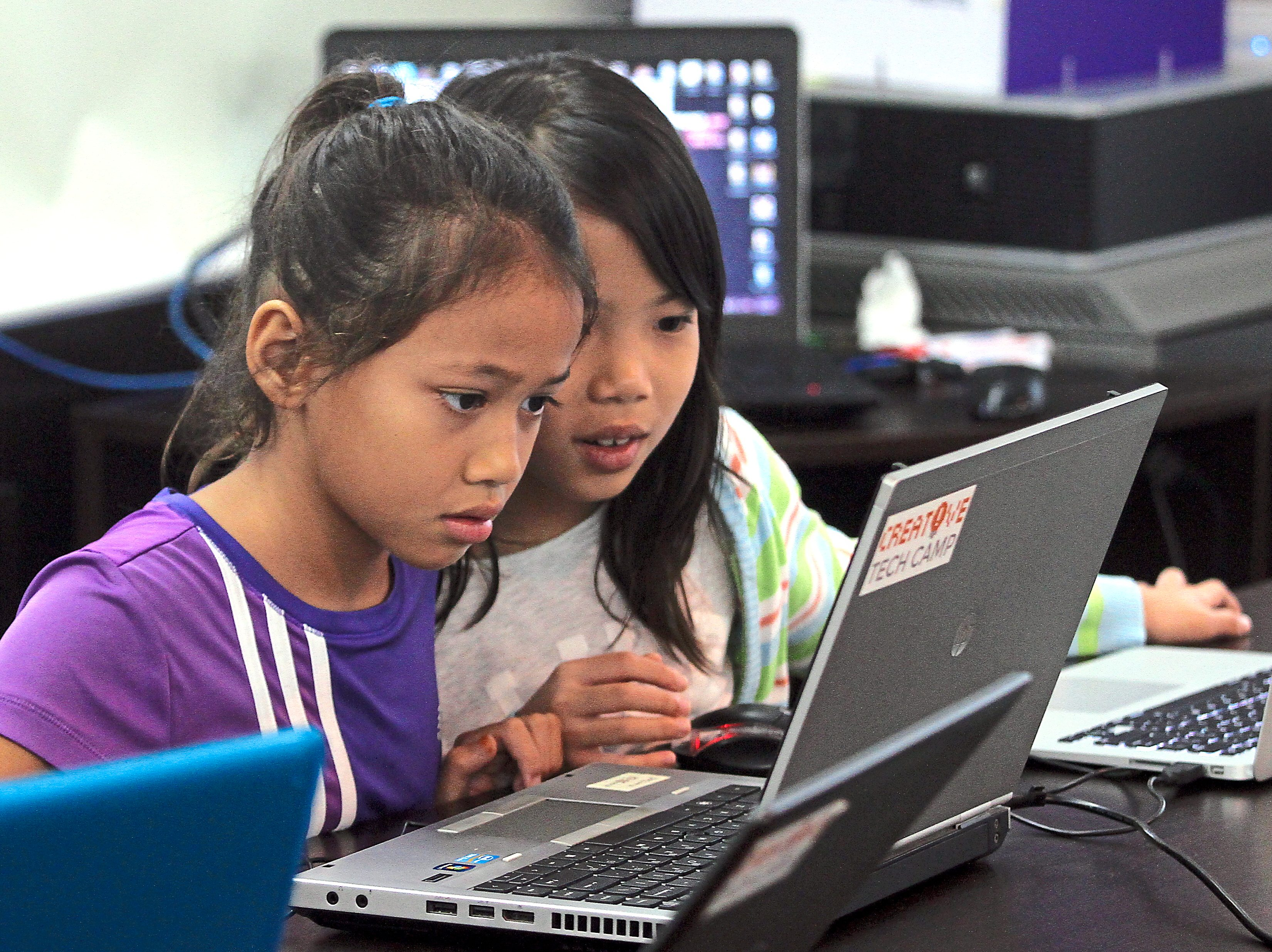 1 Sharifah Jamilla (left) and Hu Yue putting their heads to alter the world of Minecraft using Forge.2 Calvin Kuo gives a crack at coding in Java.— Photos: CHAN TAK KONG/The Star