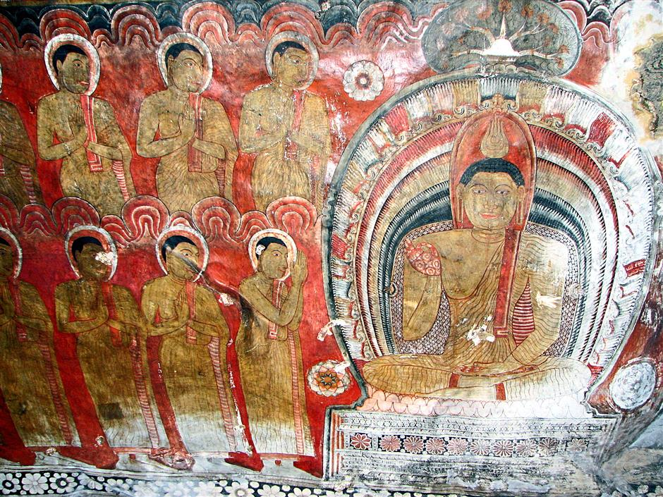 Buddha paintings in Dambulla cave temple in Sri Lanka.