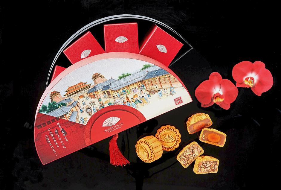 Decadent, handcrafted mooncakes from Mandarin Oriental, Kuala Lumpur presented in iconic fan-shaped boxes.