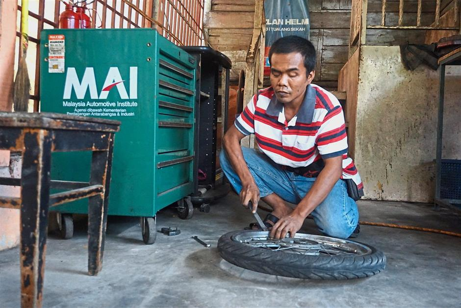 Independent businessman: Azhar has been operating his workshop since 2008.