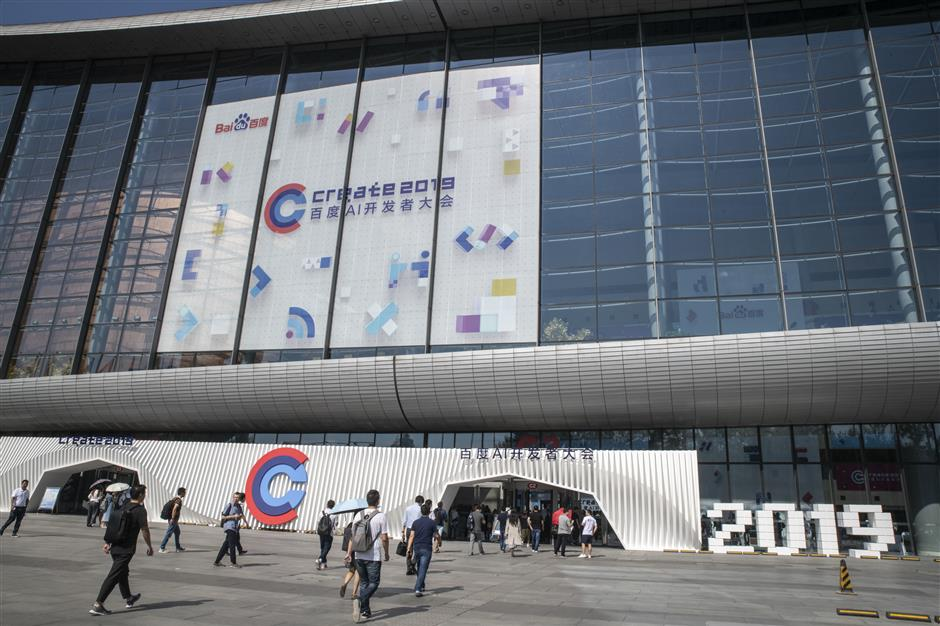 Attendees arrive for the Baidu Developers Conference in Beijing, China, on Wednesday, July 3, 2019. Baiduu00a0Inc. is fighting on a number of fronts as the slowing Chinese economy dampens advertising sales and its desktop search business loses users to smartphones. Photographer: Gilles Sabrie/Bloomberg