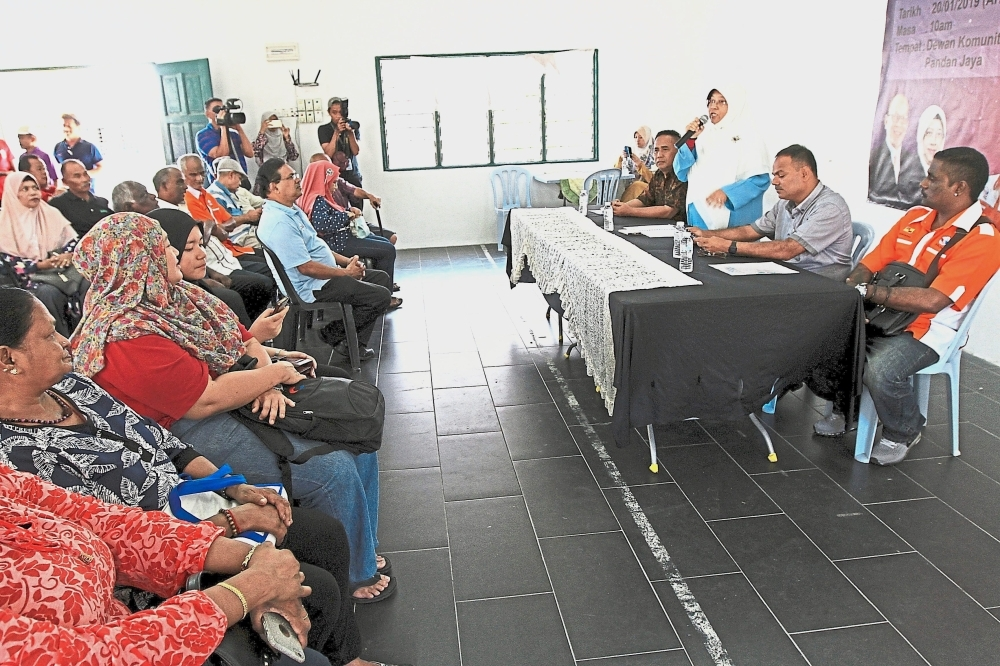 Haniza (standing, right) during a dialogue with Taman Pandan Jaya low-cost flats residents.