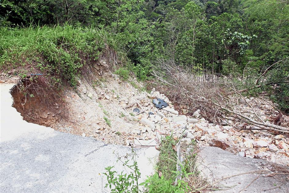 The trail into Bukit Cerakah has caved in following land-clearing activities. (Right) The entrance to the walking trail in Bukit Cerakah has been barricaded.