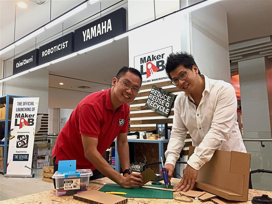 Lam (right) and Wong believe that encouraging the habit of repairing will not only reduce waste but may even lead to creating innovators.