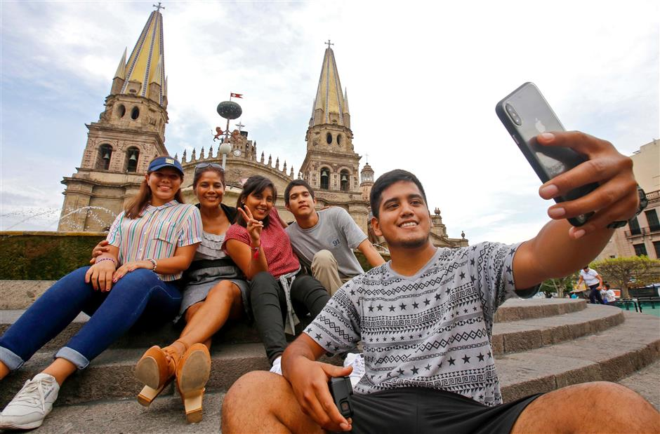 Tourists make a selfie in front of the Cathedral of Guadalajara, Jalisco state, Mexico, on June 19, 2019. (Photo by Ulises Ruiz / AFP)