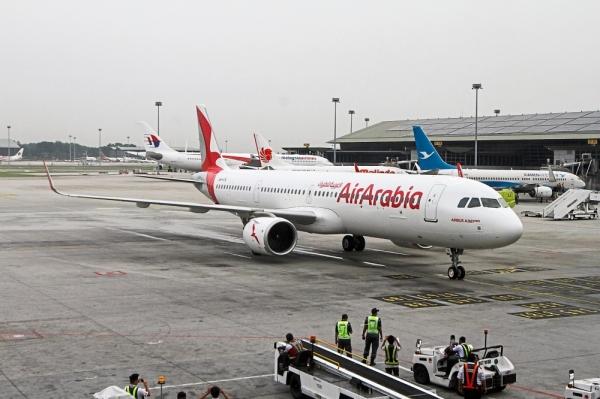 Inaugural flight: The Air Arabia flight landing at the KL International Airport.