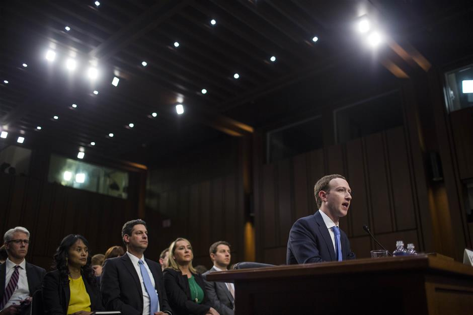 WASHINGTON, DC - APRIL 10: Facebook co-founder, Chairman and CEO Mark Zuckerberg testifies before a combined Senate Judiciary and Commerce committee hearing in the Hart Senate Office Building on Capitol Hill April 10, 2018 in Washington, DC. Zuckerberg, 33, was called to testify after it was reported that 87 million Facebook users had their personal information harvested by Cambridge Analytica, a British political consulting firm linked to the Trump campaign. Photo by Zach Gibson/Getty Images) == FOR NEWSPAPERS, INTERNET, TELCOS & TELEVISION USE ONLY ==