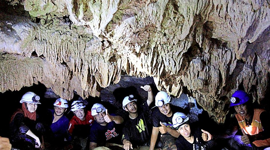 The cavers from Tourism Malaysia Pahang,  Tourism Ministry Pahang Office, Media Pahang having their group picture at the entrance of the Gua Padang Kawad in Merapoh.PIX NIK NAIZI HUSIN/THE STAR