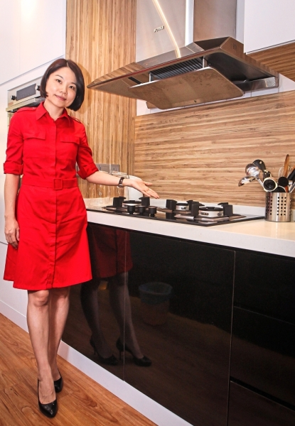 Tang showing the kitchen hood and hob. — Photos by MUHD SHAHRIL ROSLI/ The Star