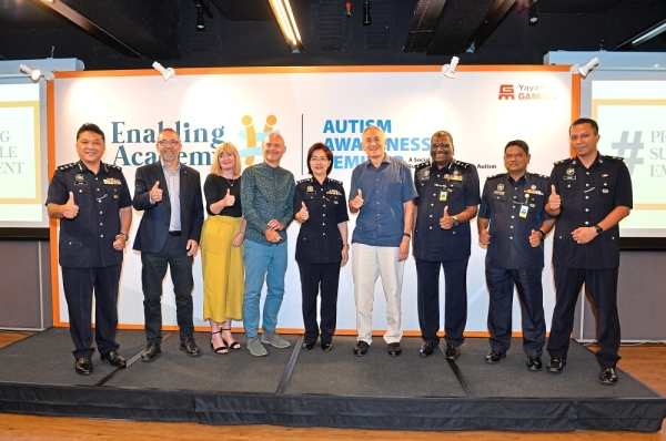 Striving for change: Among the attendees at the EA autism awareness seminar were police personnel led by Bukit Aman DCP Datuk Lee Bee Phang and SAC Munusamy who shared that the police force has recently reviewed guidelines and SOP on handling suspects with autism.