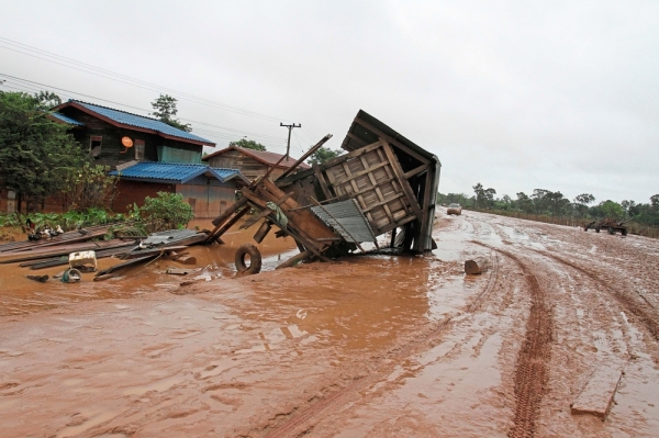 Broken apart: A shelter damaged by floodwaters lying on the road in a village in Sanamxai, Attapeu province, in this 2018 file photo. u2014 AFP