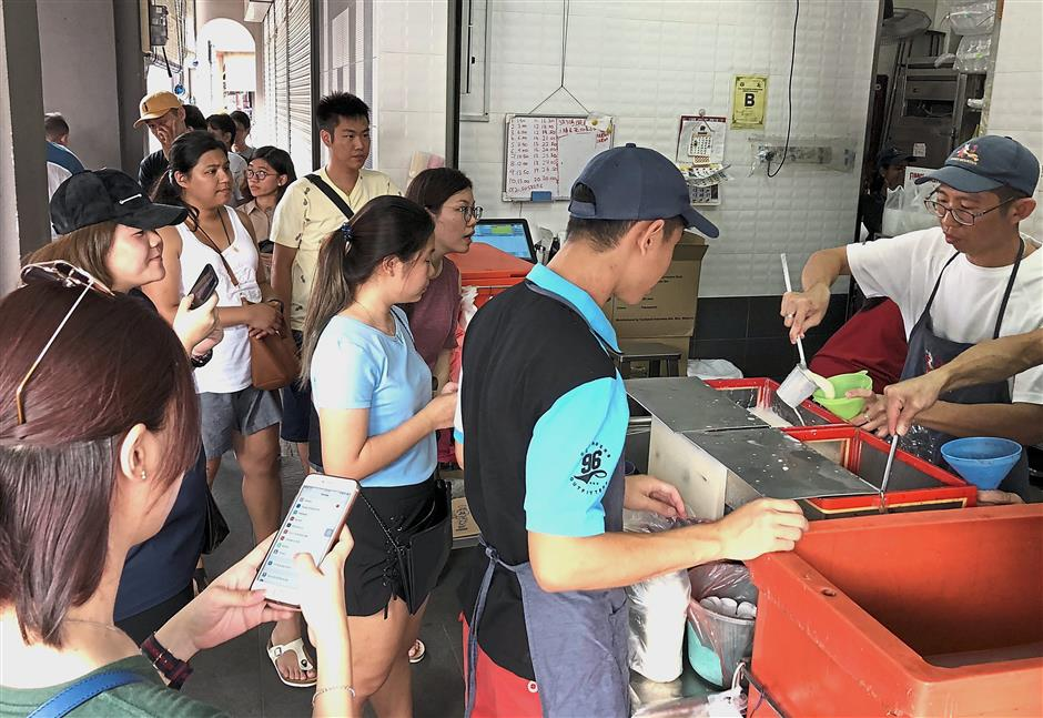 Visitors queueing up for Ipoh's famous soy bean drink and tau fu fah during the Chinese New Year holidays.