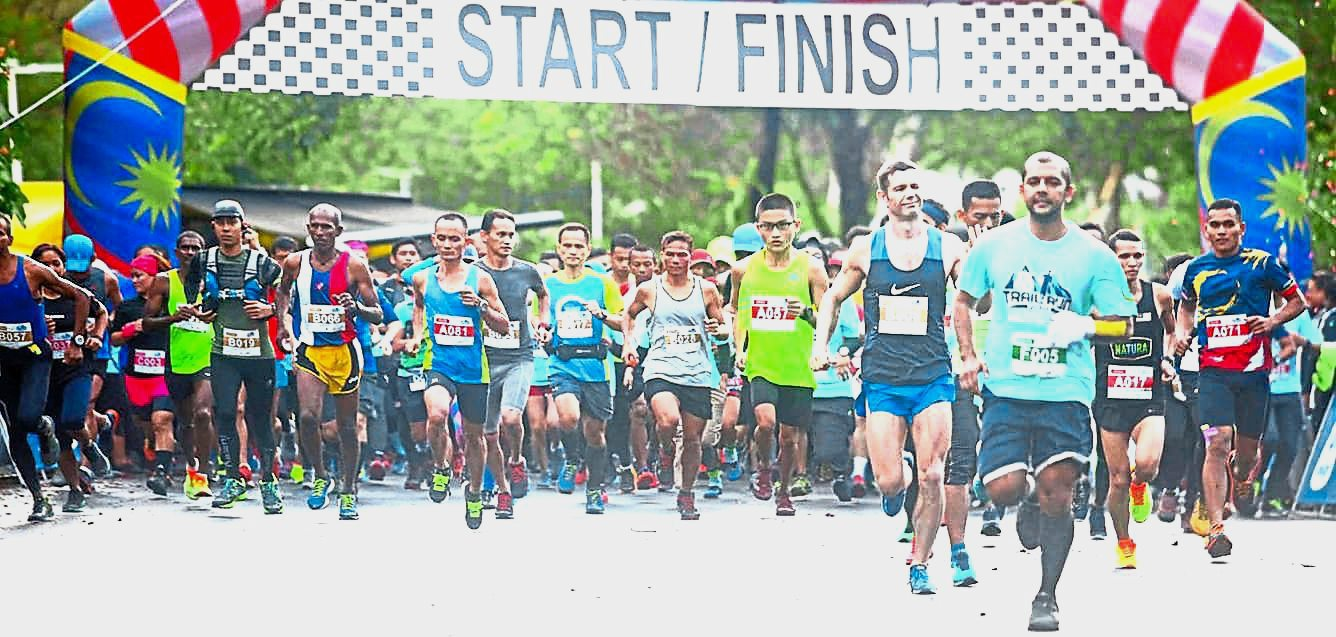 (Top) Participants of the Deuter Trail Run 2018 at the start of the race at Bukit Larut Forest Reserve in Taiping, Perak.