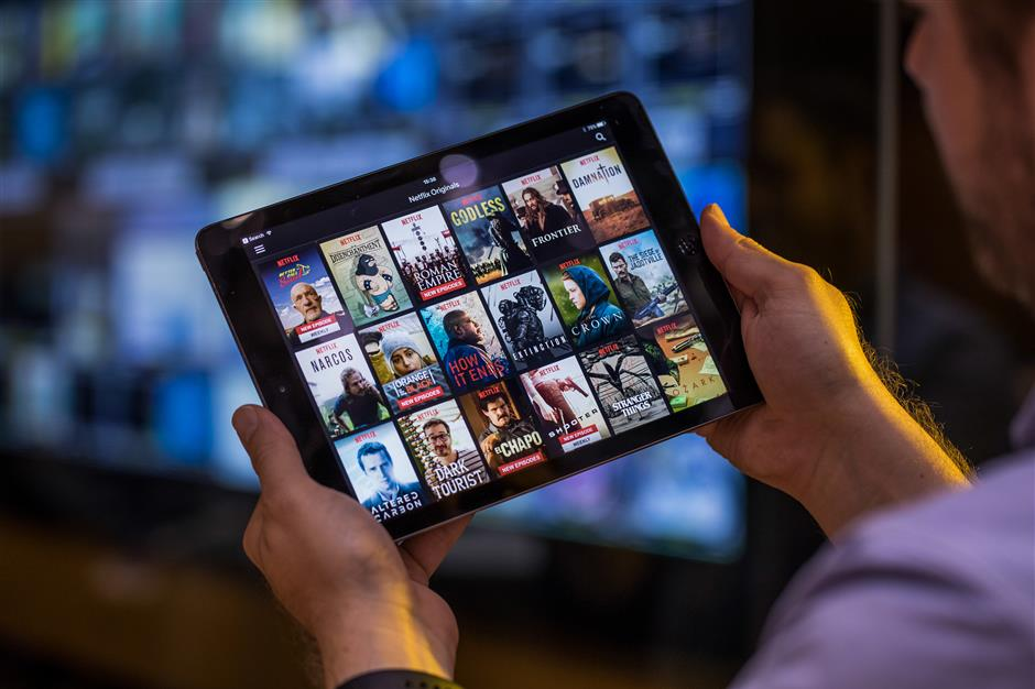 A selection of Netflix Inc. original content sits displayed in the Netflix app on an Apple Inc. iPad tablet device in this arranged photograph in London, U.K., on Monday, Aug. 20, 2018. The NYSE FANG+ Index is an equal-dollar weighted index designed to represent a segment of the technology and consumer discretionary sectors consisting of highly-traded growth stocks of technology and tech-enabled companies. Photographer: Jason Alden/Bloomberg