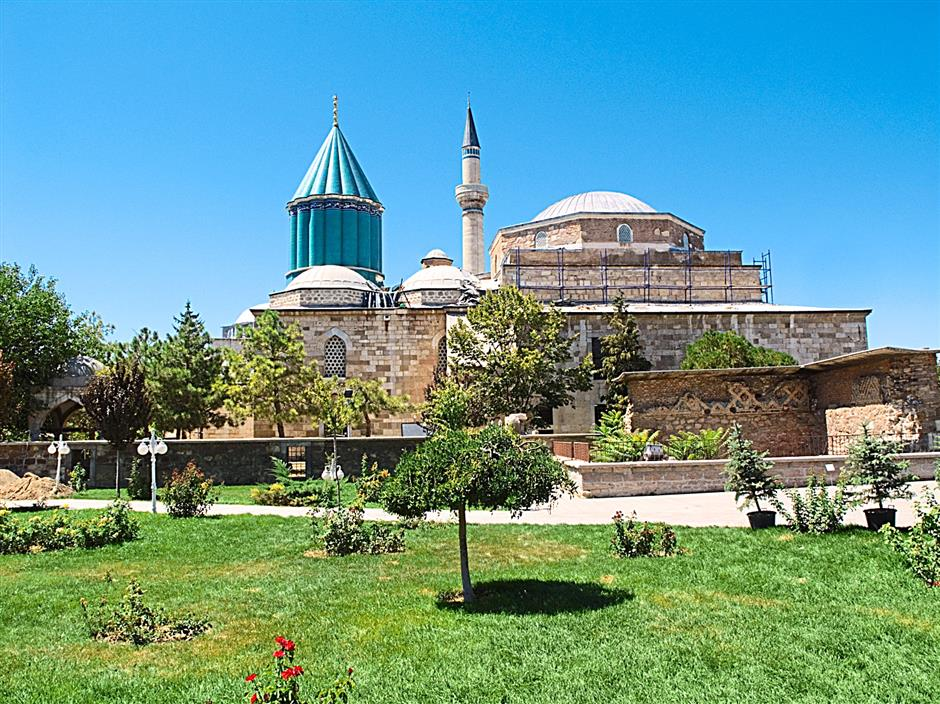 The exterior of the Mevlana Museum. The former dervish hall now holds the tomb of Jalal ad-Din Muhammad Rumi, founder of the Mevlevi order of dervishes.