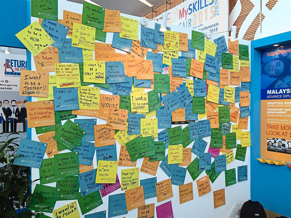 Participants writing down their dreams for the future at the Department of Skills development booths.