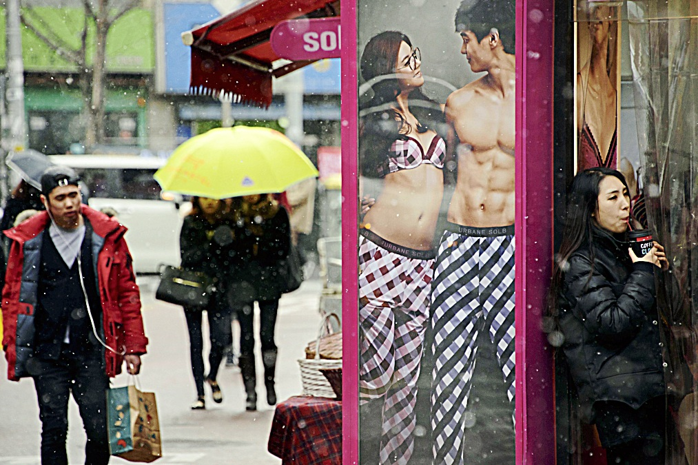 To go with Lifestyle-love-SKorea-fashion,FEATURE by Jung Ha-wonIn a photo taken on February 9, 2014 a poster advertises matching pyjamas for couples at a popular shopping area in Seoul. Young South Korean couples often advertise their relationship by wearing matching outfits, whether socks, shirts, jackets or, more privately, underwear. The trend has spawned a small cottage industry, with specialist online stores offering