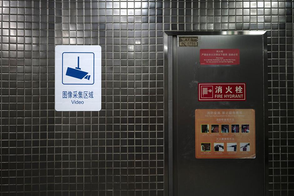 A sign indicating surveillance cameras in operation is displayed inside a subway station in Beijing, China, on Friday, May 31, 2019. China spent about $180 billion on domestic security in 2017, exceeding the national defense budget by nearly 20 percent, according to anu00a0analysisu00a0of data from China's Ministry of Finance by scholar Adrian Zenz. Photographer: Giulia Marchi/Bloomberg