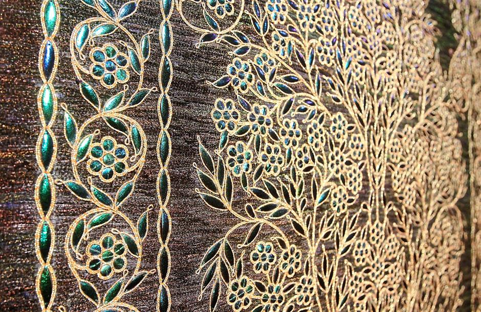 Asif Shaikh of India's Tree of Life done in woven peacock feathers, embroidered with beetle wings and pleated silver threads.