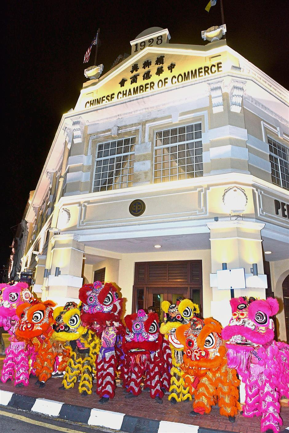 Lion dance troupes performing outside the building during the lighting up ceremony.