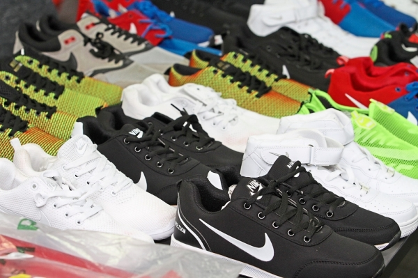 Some of the counterfeit sports shoes seized by the ministry at the night market in Batu Ferringhi.
