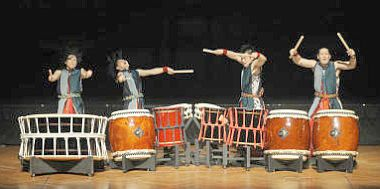 Hitting the skins: Members of the Yamato drumming troupe engage in a playful u2018battle of the drumsu2019 during their performance last week.