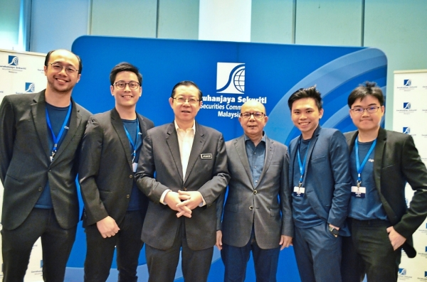 New platform: Ang (second from right) and his team are seen with Finance Minister Lim Guan Eng (third from left) and SC chairman Datuk Syed Zaid Albar (fourth from left). CapitalBay will join the ranks of local P2P financing platforms.