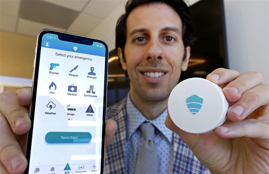 Titan HST Chief Executive Vic A. Merjanian created an app to help with emergency communications. He is partnering with Exoio founder Shawn Dougherty to make and market new sensor hardware, right, to help pinpoint app users' locations during emergencies. (Luis Sinco/Los Angeles Times/TNS)