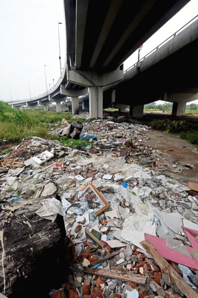 The area has become a dumping site for construction waste.