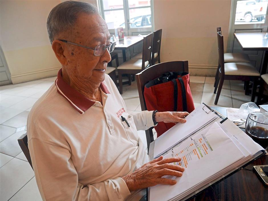ipakampar220815 12... Former Kampar MP and developer Tan Sri Hew See Tong looking at his file, where he meticulously keeps the history of Kampar, and records of the projects he had undertaken throughout the years to develop Kampar into an international education hub.