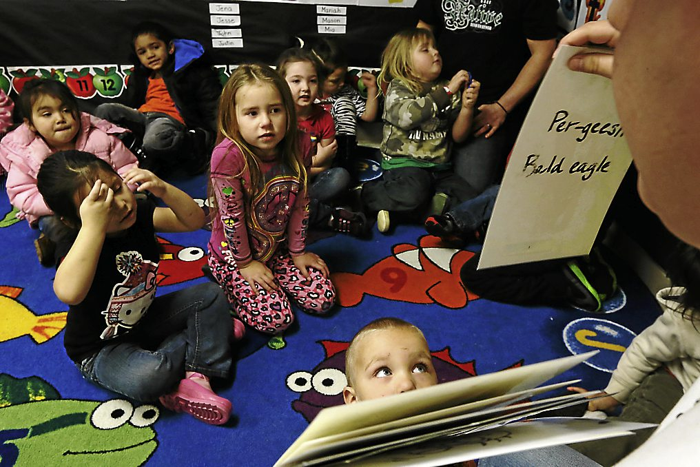 The Yurok tribal language revitalisation programme has developed curricula for all ages; here, Mike Carlson, 19, teaches pre-school age children Yurok words at the Klamath Family Head Start programme.
