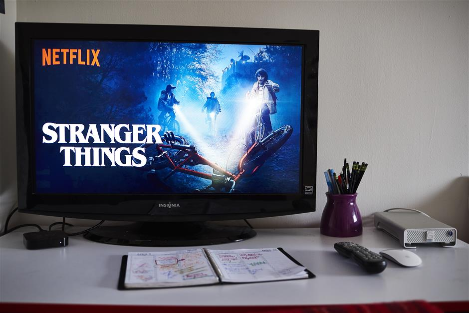 A television monitor displays the home screen for the Netflix Inc. original series 'Stranger Things' in an arranged photograph taken in the Brooklyn Borough of New York, U.S., on Thursday, April 12, 2018. Netflix Inc. is scheduled to release earnings on April 16. Photographer: Gabby Jones/Bloomberg