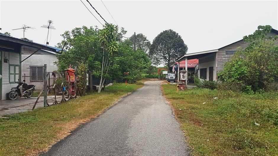 A view of the typical roads and homes found in the village. Lims house is on the right. — Photos: FOONG PEK YEE/The Star